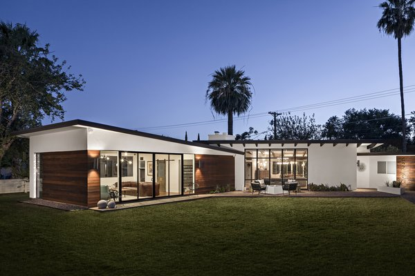 Modern home with outdoor, grass, small patio, porch, deck, and pavers patio, porch, deck. Mid-century Modern Addition Photo  of Modern Manor