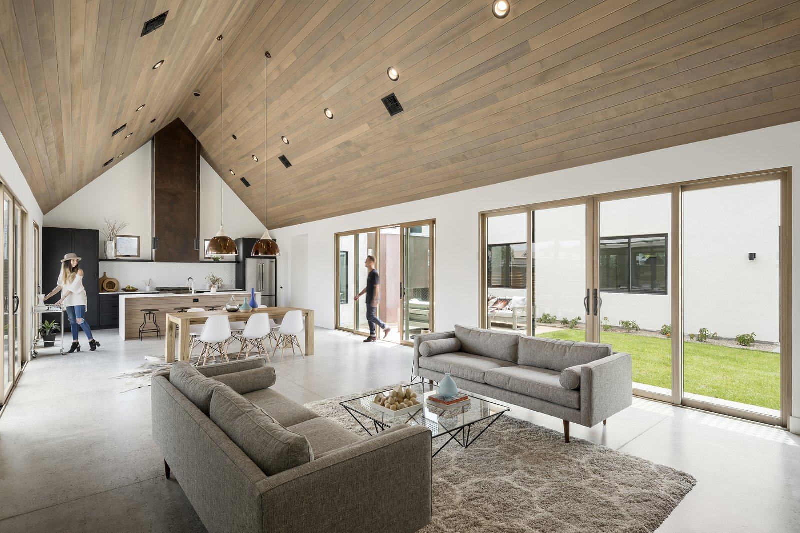 Great room with vaulted ceiling and flooded with natural light from the north and south Tagged: Living Room, Ceiling Lighting, Coffee Tables, Sofa, and Concrete Floor.  Canal House by The Ranch Mine