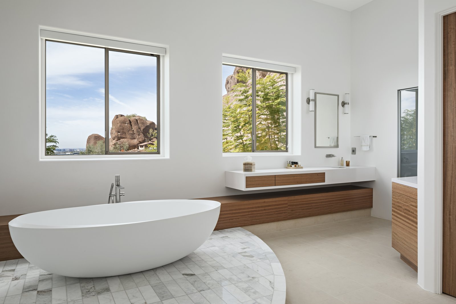 Freestanding tub and custom vanities with views of Camelback Mountain