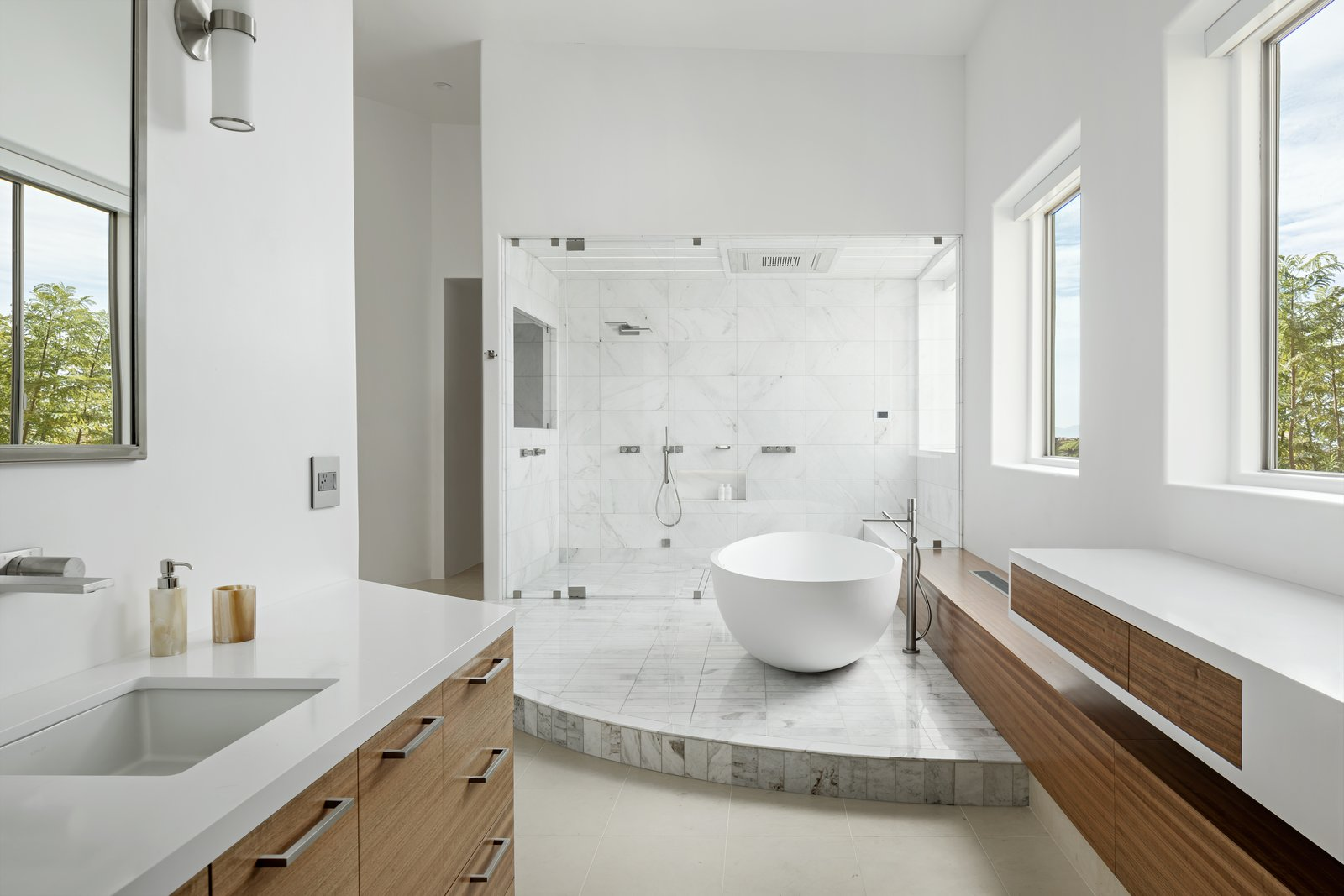 Both vanities with freestanding tub and steam shower in the background