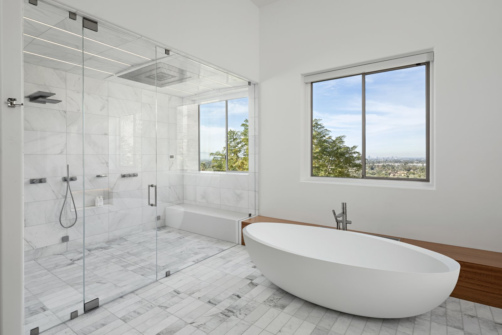 Freestanding tub and Steam Shower with views of downtown Phoenix