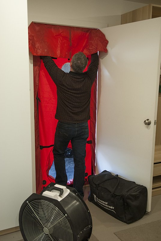 Our HERS specialist Rob is installing the fan for a blower door test  Gallery by evoDOMUS LLC