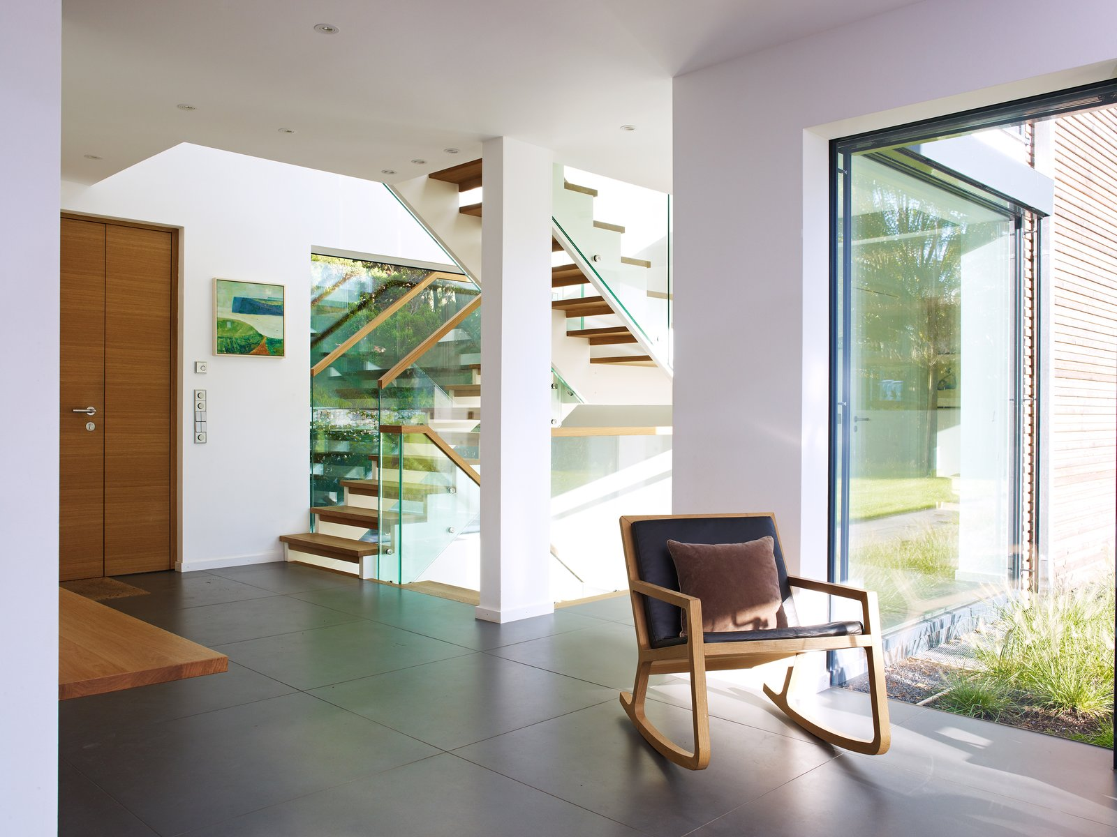 Open stair with glass railing  Gallery by evoDOMUS LLC