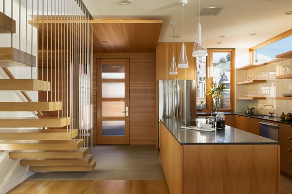 Kitchen + Entry Photo 11 of Roads End Beach House modern home