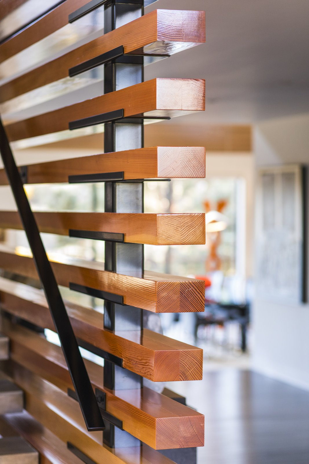 The entry/stair screen wall is made of fir timber that was slipped over steel posts and sits on a custom made bracket.