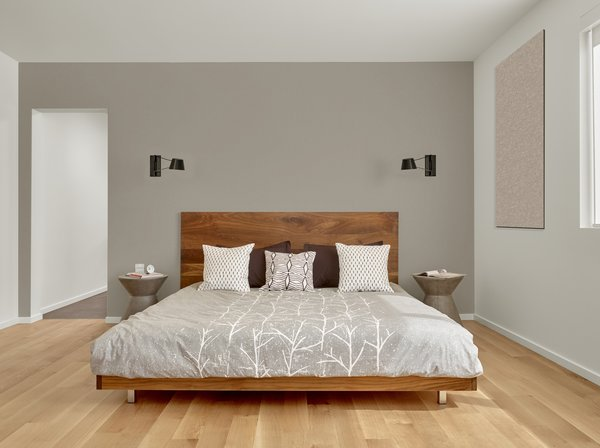 The walnut master bed frame is custom by Matt Eastvold. The sconces are by Brendan Ravenhill. Photo 10 of Trestle Glen Modern modern home