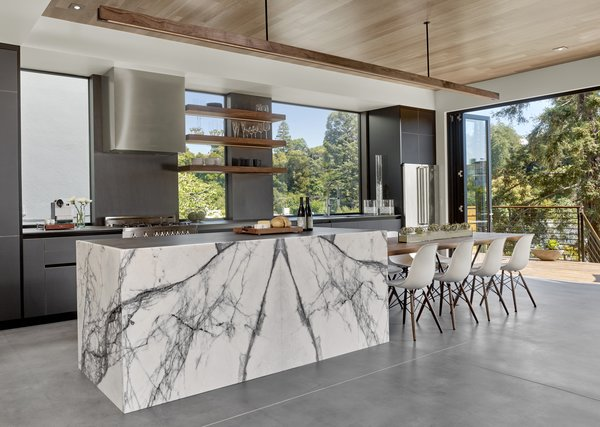 The cabinets are black matte glass by Leicht. The floating walnut table, shelves and light are by Matt Eastvold. Photo 5 of Trestle Glen Modern modern home