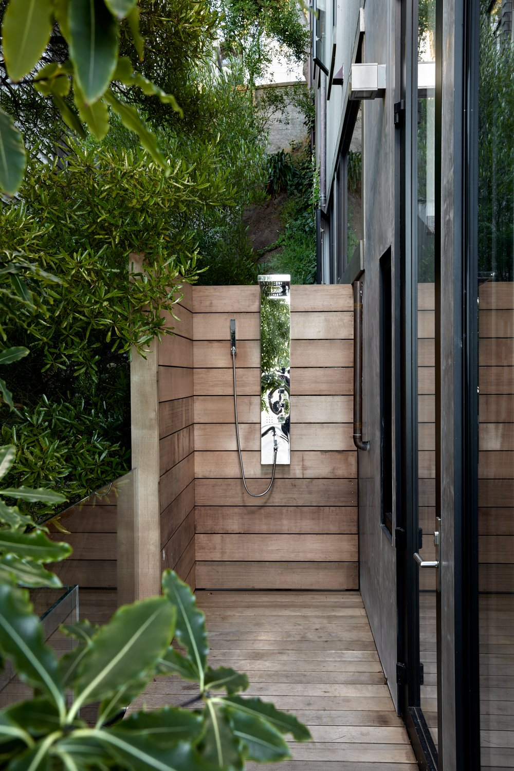 An outdoor shower is concealed in the side yard and features a weathered  cedar slat enclosure. Tagged: Outdoor, Small, Shower, Side Yard, Trees, Shrubs, Wood, Decking, Horizontal, Wood, and Landscape.  Best Outdoor Decking Landscape Photos from Twin Peaks Escape Pad