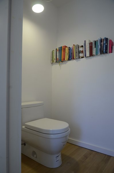 Who doesn't read in the loo? Photo 10 of Norfolk Manor modern home