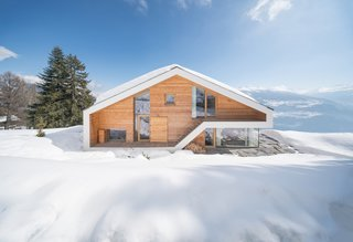 13 Epic Alpine Retreats We're Swooning Over - Photo 7 of 13 - Inspired by traditional chalets of the Swiss Alps, Dutch architects SeARCH designed this 500-square-meter home as a single, visually clear volume with wood cladding and decidedly modern glazing and windows.