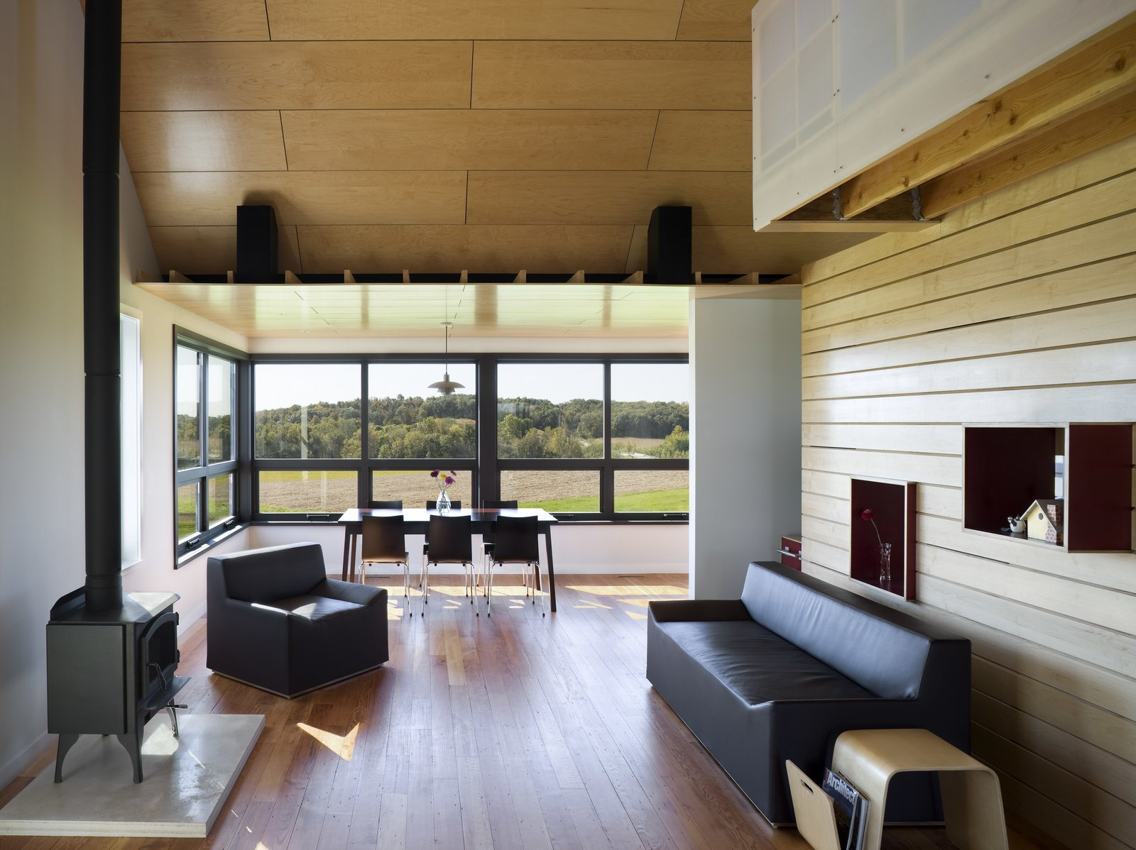 Yum Yum Farm in Iowa Tagged: Living Room, Wood Burning Fireplace, Chair, Sofa, and Medium Hardwood Floor.  Photo 6 of 11 in Dwell's Top 10 Design Pros of 2017 from Yum Yum Farm