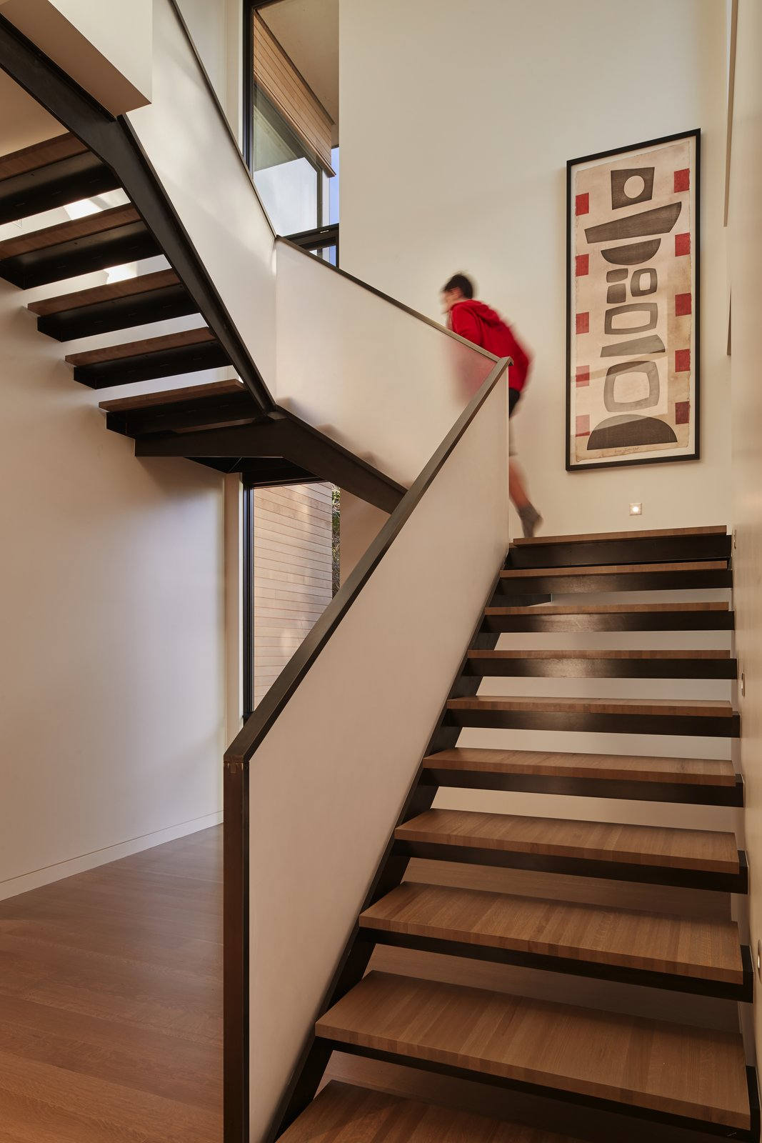 """Custom """"grasshopper"""" stair Tagged: Staircase, Metal Railing, and Wood Tread.  Best Photos from Union Bay Residence"""