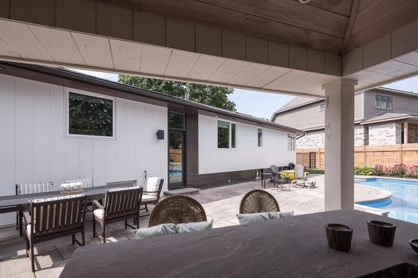 The material palette on the pool side elevation is lighter than the road side. Photo 12 of Burlington Residence modern home