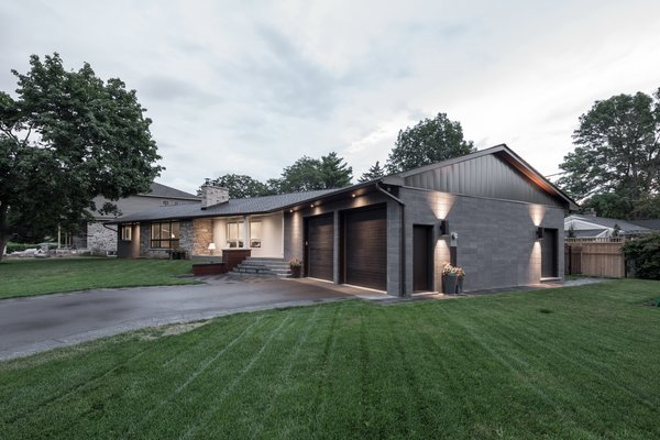 The angle of the original house had no bearing to either street on the corner, the addition (perpendicular/parallel to the streets on the corner) introduces a contextual geometry to the scheme.  Photo 6 of Burlington Residence modern home