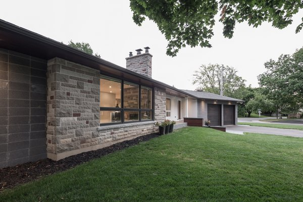 The existing stone was a central material in the project's material palette. It disciplined all subsequent material selections. Photo 3 of Burlington Residence modern home