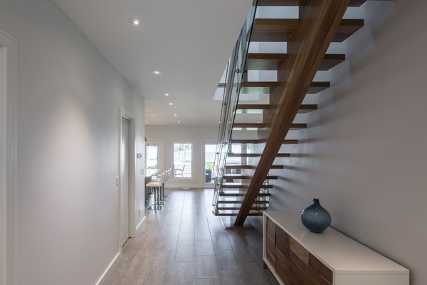 The idea was that from the moment you entered the house, you were aware of the water, consequently, the stair was designed with open risers. Photo 10 of Turkey Point Beach House modern home