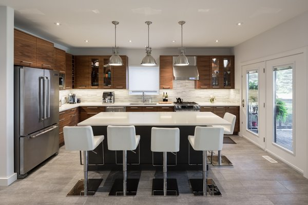 The kitchen island is a hub in the design. Photo 16 of Turkey Point Beach House modern home
