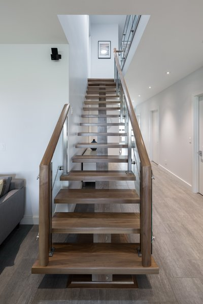 The stair design intention was to make it solid and light. Photo 20 of Turkey Point Beach House modern home
