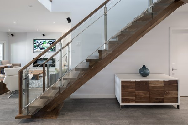 The stair is also solid American walnut, built from a single log. Photo 19 of Turkey Point Beach House modern home