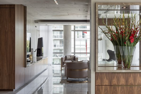 Custom millwork was inserted into the space to not only house it's function, but also give definition to the spaces. The openness or intimacy of spaces are defined by the millwork. Photo 5 of Thompson Hotel Private Suite modern home