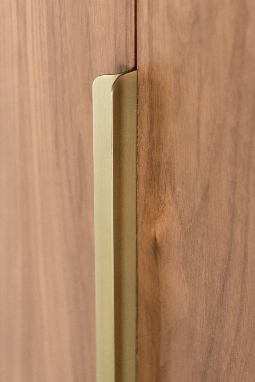 The door pulls were also custom designed and locally fabricated from brushed brass.