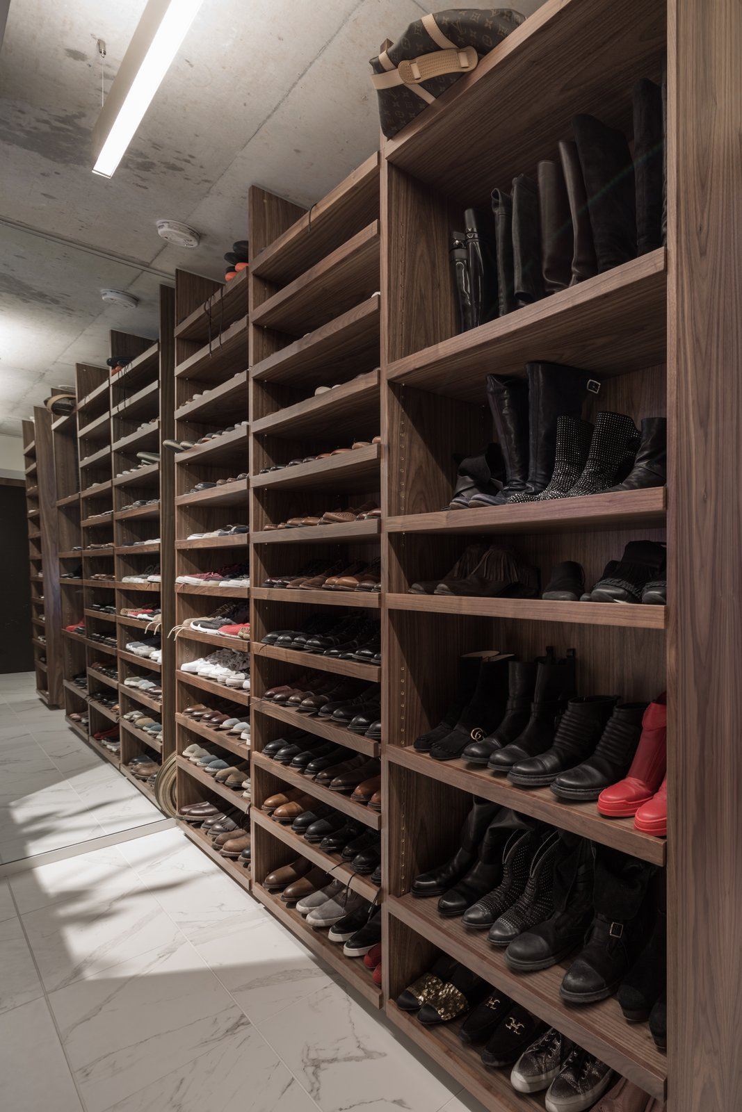 There was a need for a lot of shoe storage.  Thompson Hotel Private Suite by ANTHONY PROVENZANO ARCHITECTS