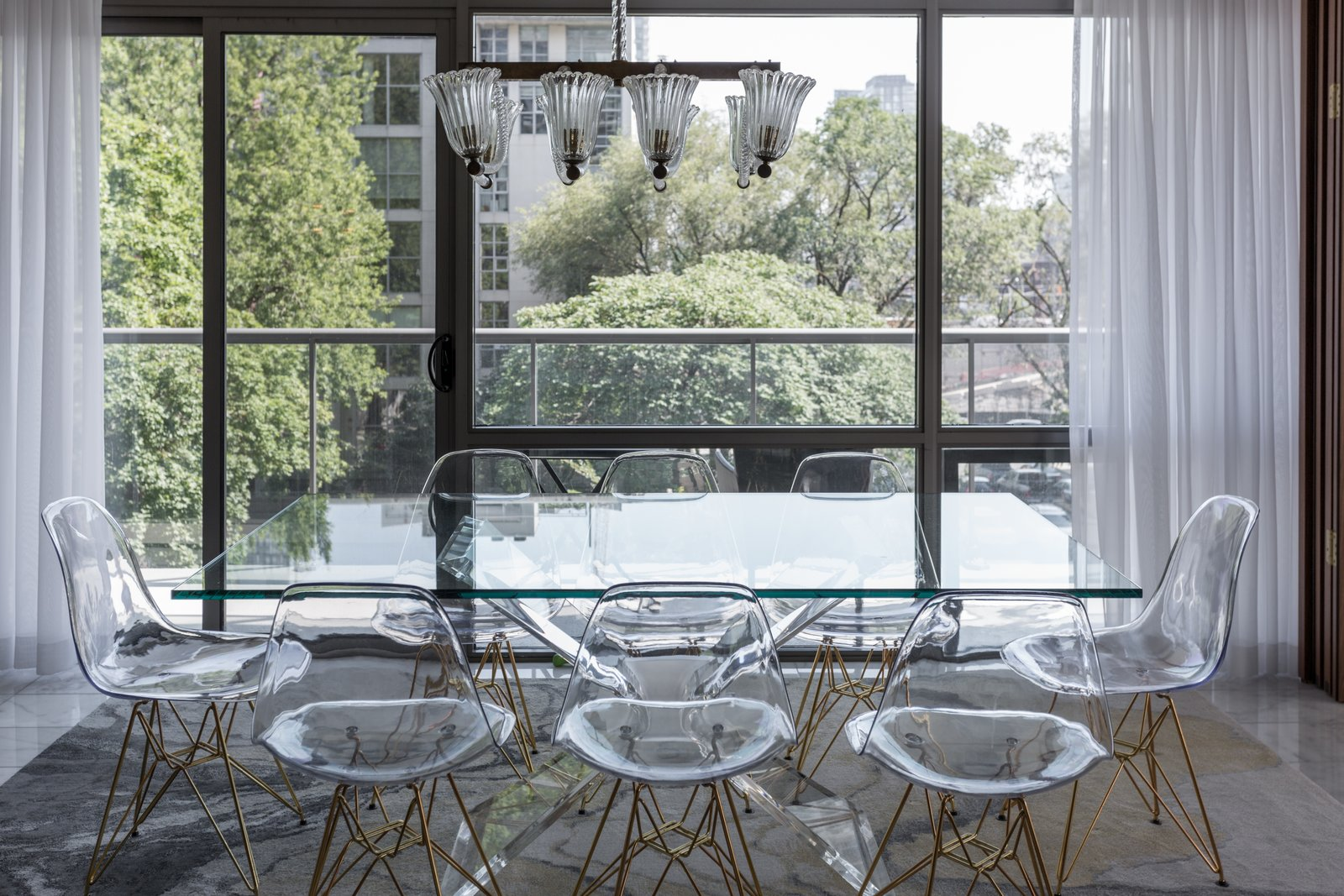 There was a great will to keep things transparent and open - which lead to a glass dining table and clear dining chairs.  Thompson Hotel Private Suite by ANTHONY PROVENZANO ARCHITECTS