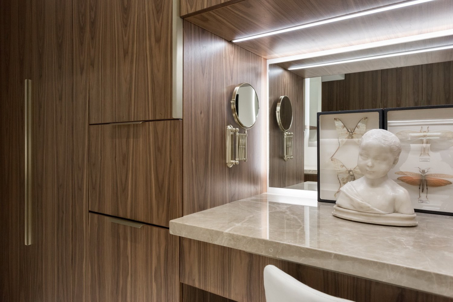 The Make Up counter is integrated into the storage units. Thompson Hotel Private Suite by ANTHONY PROVENZANO ARCHITECTS
