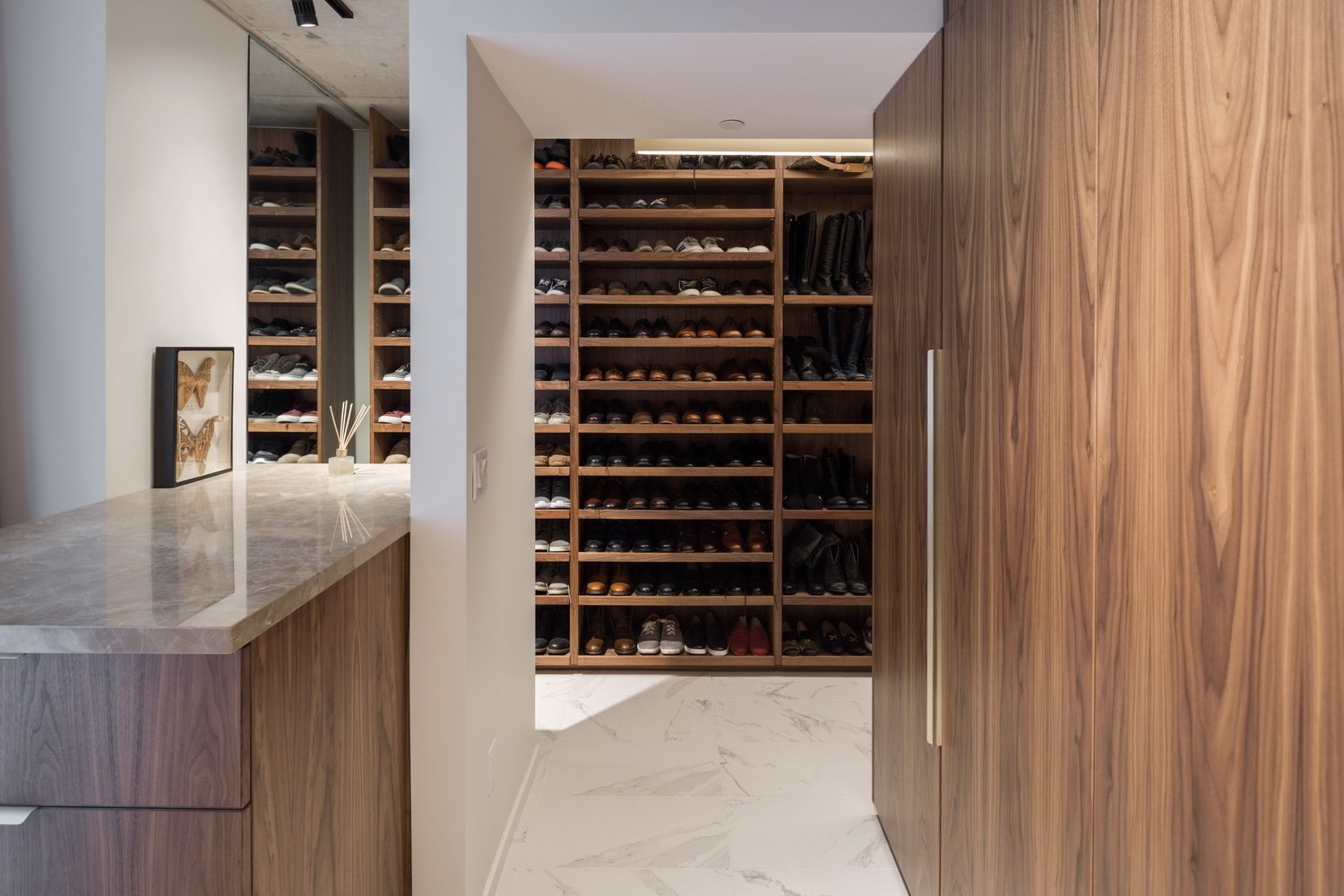 The dressing area is defined by the storage units.  Thompson Hotel Private Suite by ANTHONY PROVENZANO ARCHITECTS