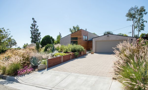 Changing the vehicular approach provides for direct garage access and allows for the drought-tolerant landscaping to contribute to both privacy and an enhanced streetscape.