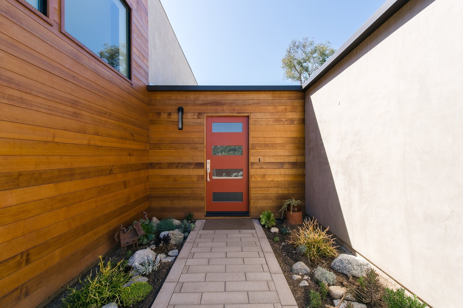 Clear cedar wraps the corner at the approach, adding warmth, texture and visual interest to the entry. Tagged: Exterior, Wood Siding Material, House, Stucco Siding Material, and Ranch Building Type.  A California Ranch Home, Reimagined by MYD studio, inc.