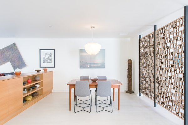 Custom teak cabinetry at the dining room creates a separation from the adjacent study while providing for storage and art surfaces at the open plan. Photo 5 of A California Ranch Home, Reimagined modern home