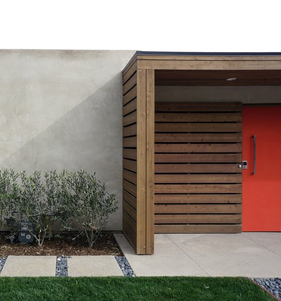 Modern home with exterior, swing door type, and outdoor. Concrete, grass, gravel and cedar at courtyard entry. Photo 2 of Laguna Niguel Mid-Century