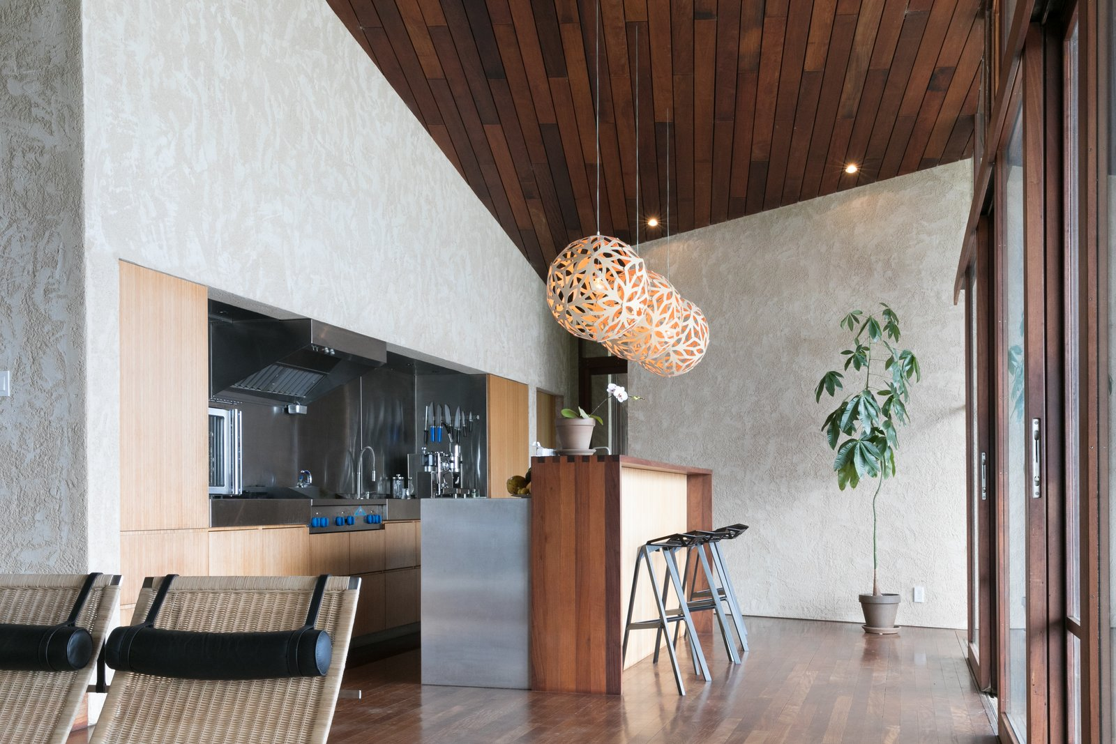 Tagged: Kitchen, Wood Cabinet, Metal Counter, Dark Hardwood Floor, Metal Backsplashe, Pendant Lighting, and Refrigerator.  The Clifftop House by Modern on Maui - Liam Ball