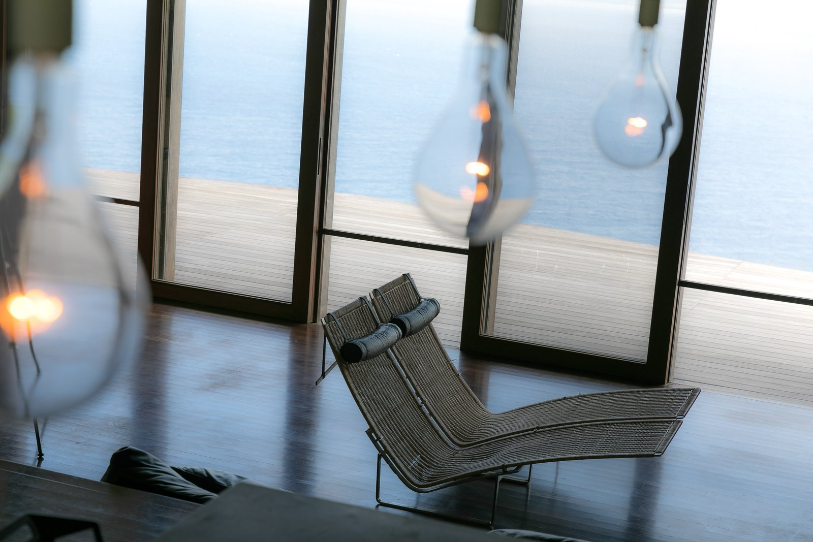 Tagged: Living Room, Accent Lighting, Dark Hardwood Floor, and Recliner.  The Clifftop House by Modern on Maui - Liam Ball