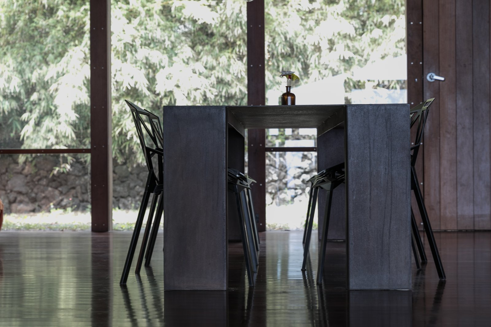 Tagged: Dining Room, Chair, Table, and Dark Hardwood Floor.  The Clifftop House by Modern on Maui - Liam Ball
