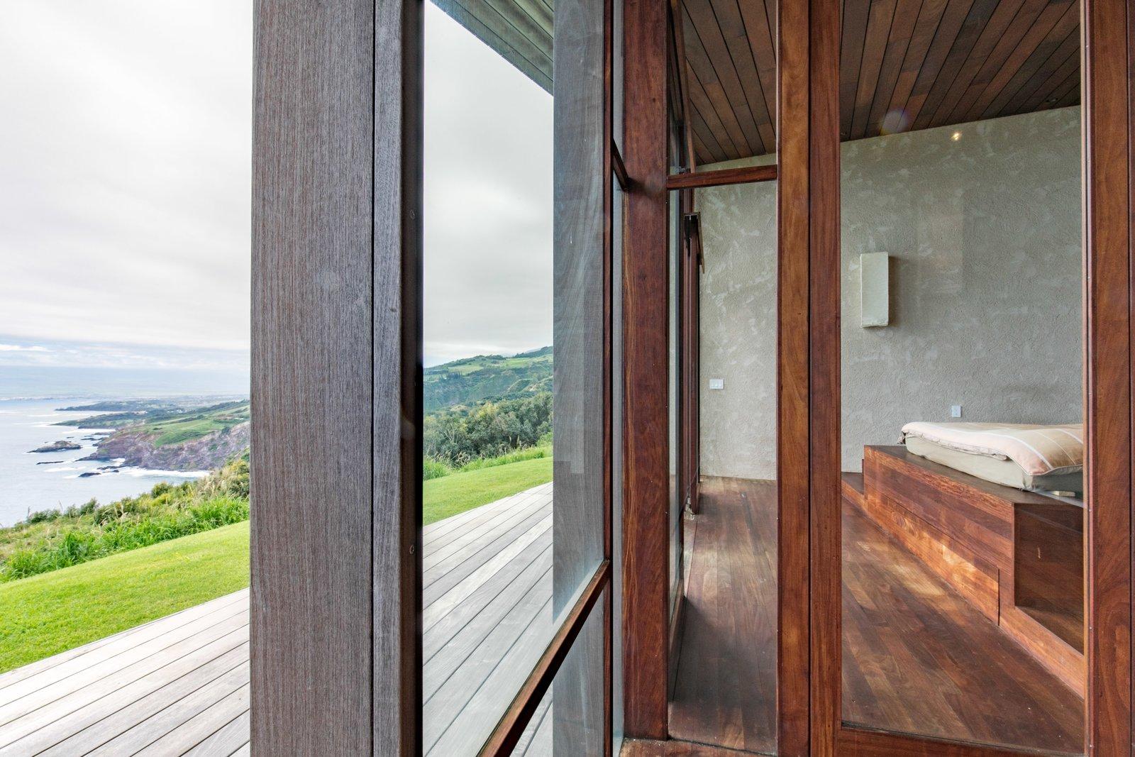 Tagged: Bedroom, Bed, Light Hardwood Floor, and Medium Hardwood Floor.  The Clifftop House by Modern on Maui - Liam Ball
