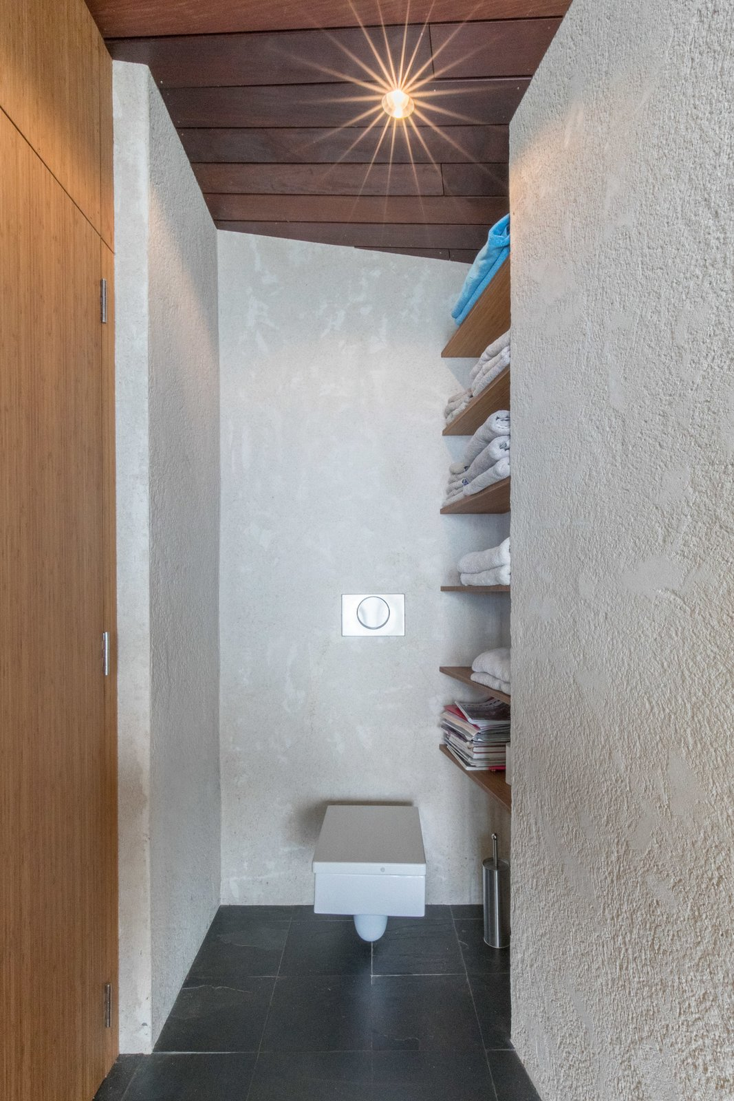Tagged: Bath Room, One Piece Toilet, and Accent Lighting.  The Clifftop House by Modern on Maui - Liam Ball