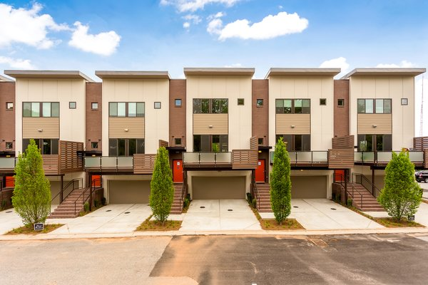 Modern home with outdoor and front yard. Photo  of Axis Townhomes