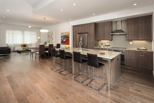 Modern home with kitchen, granite counter, and laminate cabinet. Photo 4 of Axis Townhomes