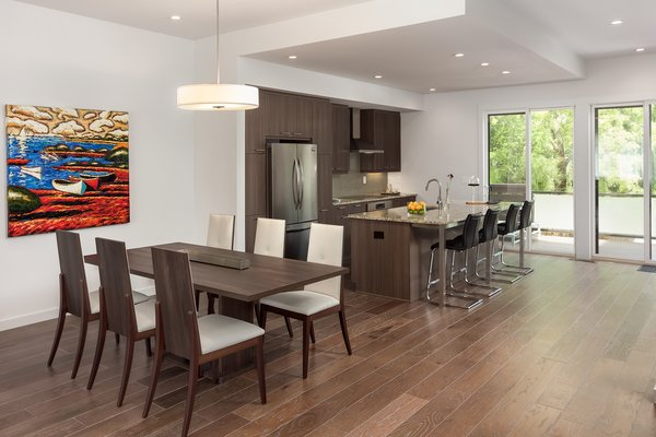 Modern home with kitchen and medium hardwood floor. Photo 5 of Axis Townhomes