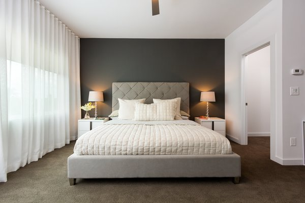 Modern home with bedroom and bed. Photo 9 of Axis Townhomes