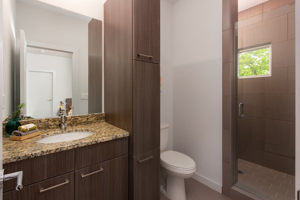 Modern home with bath room. Photo 12 of Axis Townhomes