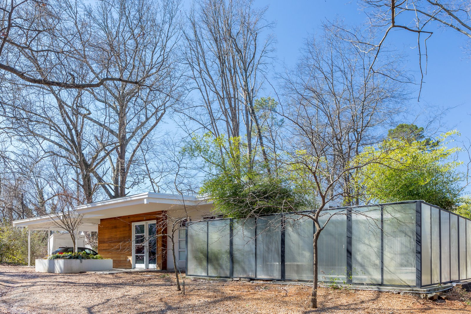Entry & Carport Tagged: Exterior, House, Wood Siding Material, and Stucco Siding Material. Custer by TaC studios