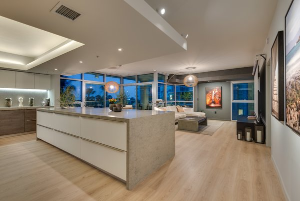 The Twelve Foot Long Assymetrical Island Anchors the Open Floor Plan Photo 2 of The Vogel Residence modern home