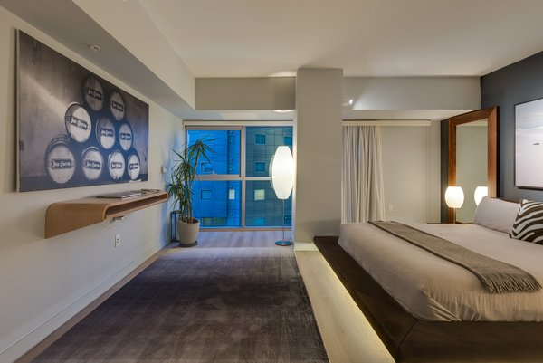 The Master Bedroom's Platform Bed is Accented with LED Lighting to Add Levity to its Mass Photo 4 of The Vogel Residence modern home