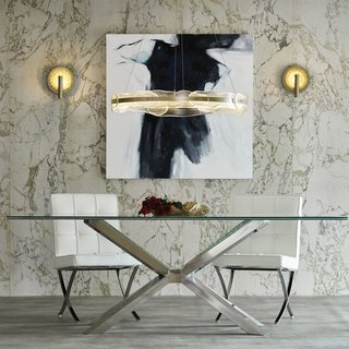 6 Essential Tips For Selecting the Perfect Dining Room Lighting - Photo 7 of 7 - Glass-covered wall sconces illuminate either side of an art piece and act as a visual connector to the glass dining table and textured glass pendant over the table.