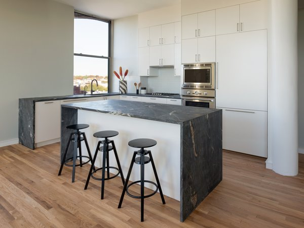 12th Street Loft - Kitchen:   #NewYork #interiordesign #architecture #architects  #light #apartment #contemporary #modern #nyc #usa #design #nice #inspiration #designer #interiordesigner #furniture #interior #home #house #kitchen #barstool  Photo 2 of 12th Street Loft modern home
