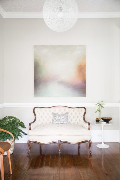 With a nod to the home's backstory, furnishings from 100 years of design history look effortless in the entry.  Turn-of-the-century partners include a 2002 Mooi Random light above a late 19th century sofa; a Cherner chair mimics the curves. Photo 9 of SOMO: southern mod modern home