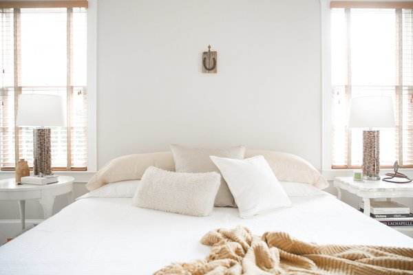 A simple artifact placed over the bed makes a tongue-in-cheek statement. Photo 14 of SOMO: southern mod modern home